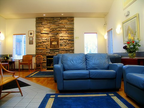 A welcoming reception area with comfy leather couches to sit on while you wait.
